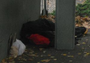 A homeless man asleep outside Seattle's First Presbyterian Church, 7th Avenue & Madison Street, Oct. 15, 2011. Photo Gary Peterson